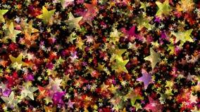 Étoiles multicolores sur le fond noir Photos libres de droits