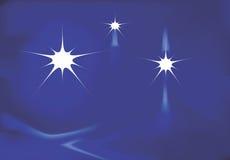 Étoiles sur le fond bleu Photographie stock