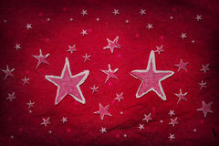 Étoiles sur le papier rouge Images stock