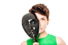 Étranger mystérieux se cachant derrière le masque Photos libres de droits
