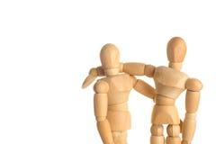 Étreignez le concept en bois de mannequin sur le fond de blanc d'isolat Images libres de droits