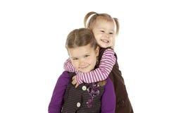 Étreindre de deux petites filles Images libres de droits