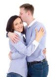 Étreindre de jeune homme et de femme d'isolement sur le blanc Photo stock