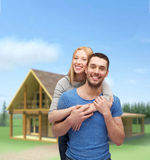 Étreindre de sourire de couples Photos libres de droits