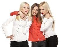 Étreindre de trois filles Photographie stock