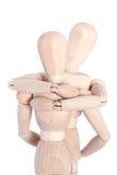 Étreindre en bois de mannequins Photo libre de droits