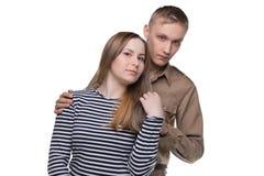 Étreindre la femme et l'homme dans l'uniforme du ` s de soldat Photo libre de droits