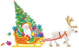 Étriers de Santa avec l'arbre et les cadeaux de Noël Photographie stock libre de droits