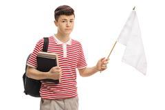 Étudiant adolescent triste tenant un drapeau blanc Photographie stock