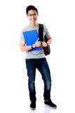 Étudiant avec la position de sac à dos et de carnet Photographie stock libre de droits