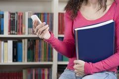 Étudiant avec le téléphone Image libre de droits