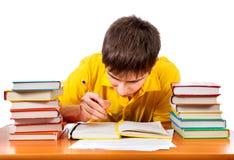 Étudiant avec les livres photos stock