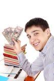 Étudiant avec un argent photo libre de droits