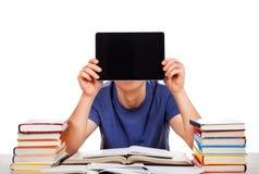 Étudiant avec un comprimé Image libre de droits