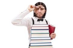 Étudiant drôle avec des livres d'isolement sur le blanc Photos libres de droits
