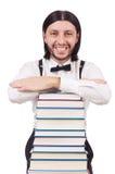 Étudiant drôle avec des livres d'isolement sur le blanc Photos stock