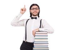 Étudiant drôle avec des livres d'isolement sur le blanc Photo libre de droits