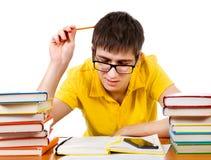 Étudiant fatigué avec livres photographie stock