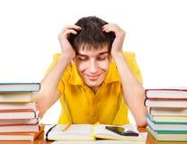 Étudiant fatigué avec livres photos stock