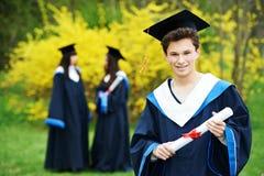 Étudiant heureux de graduation Photos stock