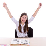 Étudiant heureux s'asseyant photographie stock