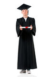 Étudiant licencié de type dans le manteau avec le diplôme Photos stock