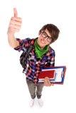 Étudiant mâle affichant des pouces vers le haut Photo stock