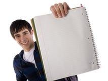 étudiant mâle de garniture de cahier de fixation Image libre de droits