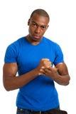 Étudiant mâle sérieux avec un geste ferme Photo stock