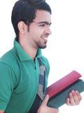 Étudiant universitaire indien au-dessus du fond blanc. Photo stock