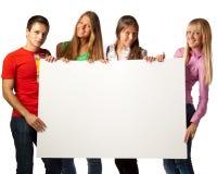 Étudiants avec le signe blanc Photographie stock libre de droits