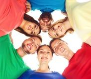 Étudiants dans l'habillement coloré se tenant ensemble Images stock