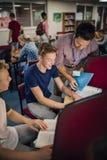 Étudiants et professeur Working On Computers Photographie stock libre de droits