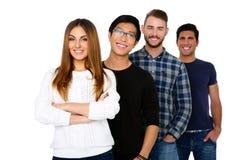 Étudiants heureux se tenant dans une rangée Photos stock