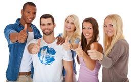 Étudiants montrant des pouces  Photo libre de droits