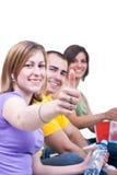 Étudiants retenant des pouces vers le haut Photographie stock