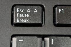 Évasion pour une clé de clavier de rupture de pause photographie stock libre de droits