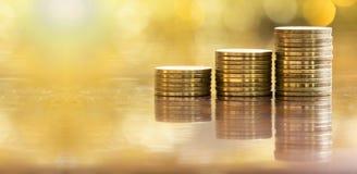 Éxito empresarial - monedas del dinero Imagen de archivo libre de regalías