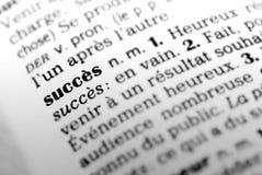 Éxito en diccionario francés Fotos de archivo