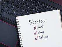 Éxito, meta, plan, acción en el cuaderno en blanco 1 Foto de archivo