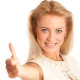 Éxito - mujer joven hermosa que muestra golpe para arriba Imagenes de archivo