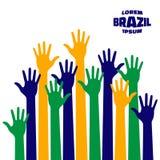 Ícone ascendente colorido das mãos usando cores da bandeira de Brasil Foto de Stock Royalty Free