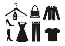 Ícone da roupa ajustado no preto Fotografia de Stock