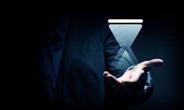 Ícone de Sandglass nas palmas Imagens de Stock