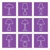Ícone do vetor do candeeiro de mesa ajustado em fundos roxos Imagens de Stock Royalty Free