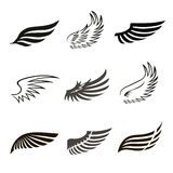 Ícones abstratos das asas do anjo ou do pássaro da pena ajustados Fotografia de Stock
