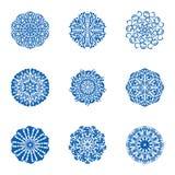 Ícones azuis isolados floco de neve ajustados Fotos de Stock