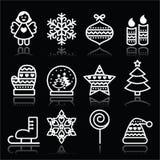 Ícones brancos do Natal com curso no preto Fotografia de Stock Royalty Free