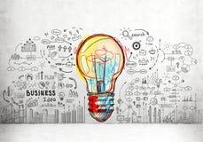 Ícones coloridos da ampola e do negócio Fotografia de Stock Royalty Free