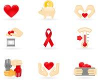 Ícones da doação e da caridade Foto de Stock